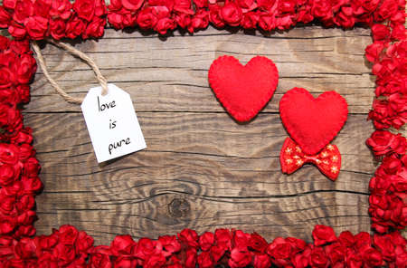 Photo for Love is pure hanging on line with couple hearts with flower frame - Royalty Free Image