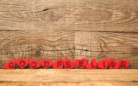 Photo for Good feeling written on felt hearts on wooden background. motivation, concept - Royalty Free Image