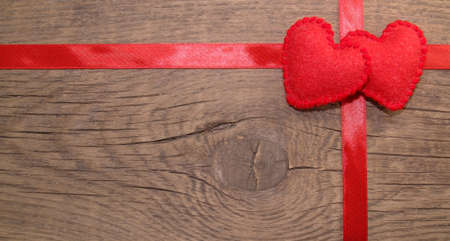 Photo for Gift wrapped frame with ribbon, with felt hearts - Royalty Free Image