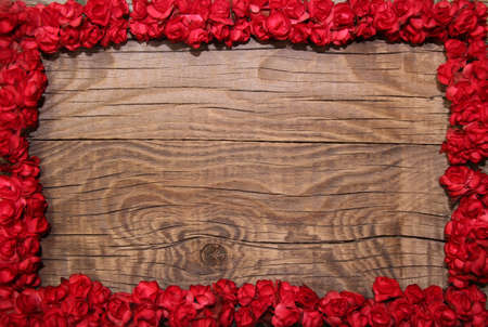 Photo for Flower frame on wooden background - Royalty Free Image