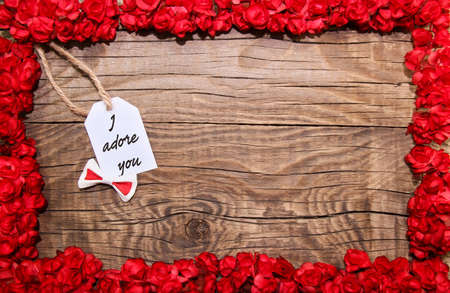 Photo for I adore you hanging on line, with flower frame - Royalty Free Image