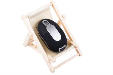 A computer mouse resting on the deck chair