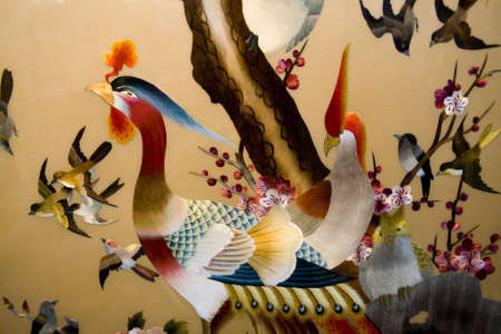 Photo pour Colorful embroidery of bird in china - image libre de droit