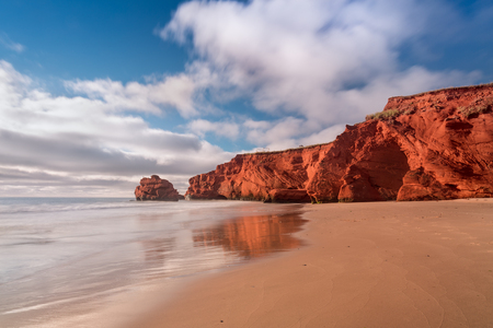 Puffs of clouds in the morning on South Dune beach, Havre-aux-Maisons in Magdalen Islands, Quebec