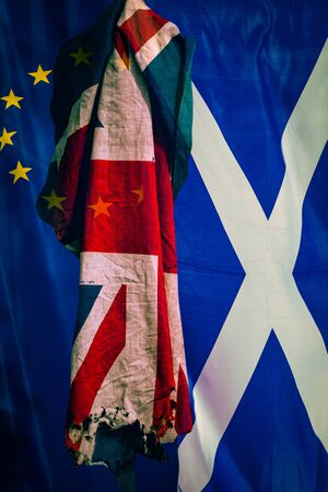 Brexit Background With Flags of European Union and Scotland With Torn United Kingdom Flag in Foreground
