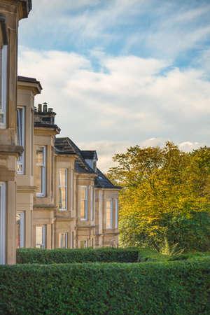 Foto de A Residential Street in Glasgow with Sandstone Terrace Houses and Autumn Leaves - Imagen libre de derechos