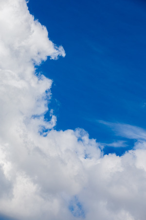 White cloud and blue sky at daylight. Close shot wit telephoto lens and polarizing filter with minimalistic composition