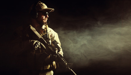 Bearded special forces soldier on dark background