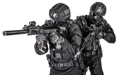 Photo for Police elite squad fighters protecting each other - Royalty Free Image