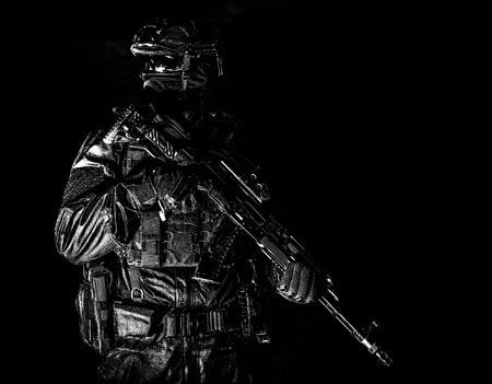 Photo pour Equipped elite forces soldier low key portrait - image libre de droit
