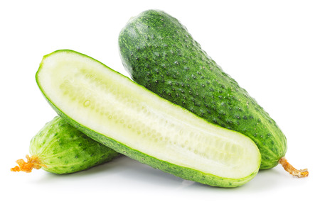 Cucumber isolated on white background. Whole and a half.