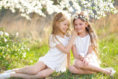 Photo for Portrait of two little girls girlfriends spring - Royalty Free Image