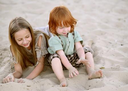 Photo pour Portrait of a boy and girl  in summer - image libre de droit