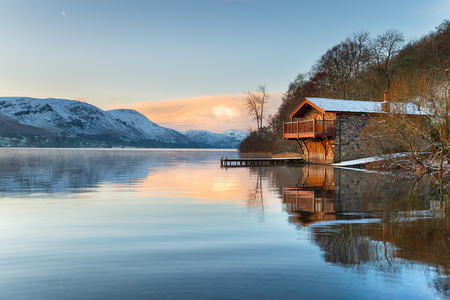 Sunrise at the old boathouse at Pooley Bridge on the shores of Ullswater in the Lake District in Cumbria