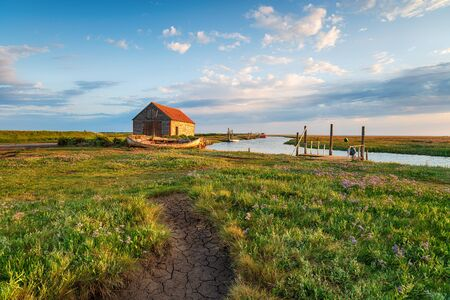 Photo for Summer at the old harbour in Thornham on the Norfolk coast - Royalty Free Image