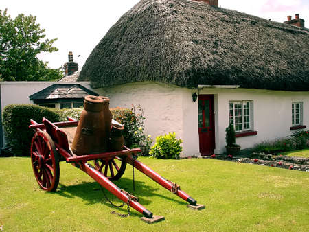 White irish thatched roof cottage in Adare, Ireland