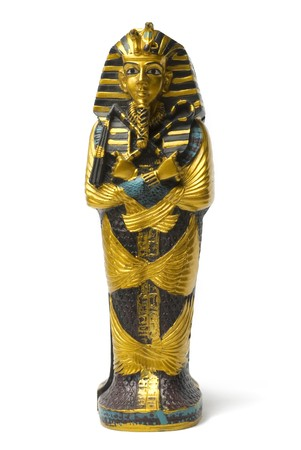 Toy golden and small pharaoh statue stays on white background