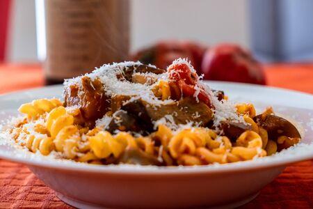 Foto de Pasta alla norma, with tomatoes and eggplants, a recipie from sicily - Imagen libre de derechos