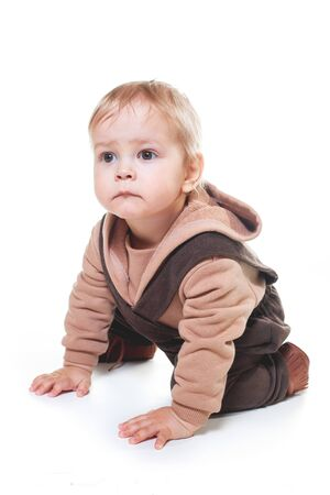 Photo for fashionable portrait of a charming one-year-old little boy on a white background, dressed in brown trousers, a beige hoodie, - Royalty Free Image