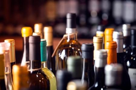 Photo pour Bottles of wine on the shelves of an alcohol shop in Spain, Alicante. Background, horizontal orientation - image libre de droit