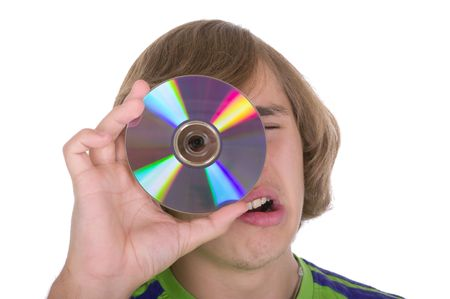 The teenager with an optical disk on a white background
