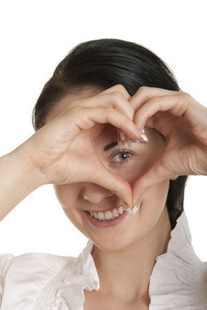 Young woman shows fingers heart symbol isolated in white
