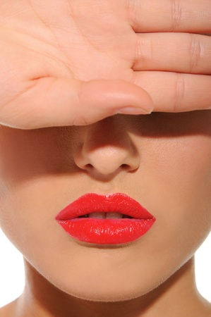 woman with red lips closes his eyes with hand