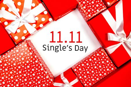 Photo pour Online shopping of China, 11.11 single's day sale concept. The red gift boxes on white and brown background with copy space for text 11.11 single's day sale. - image libre de droit