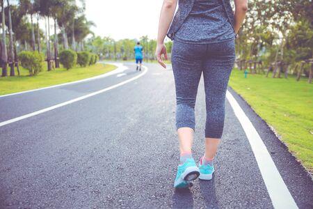 Foto de Women exercising. Runner woman running in the morning at the public park. - Imagen libre de derechos