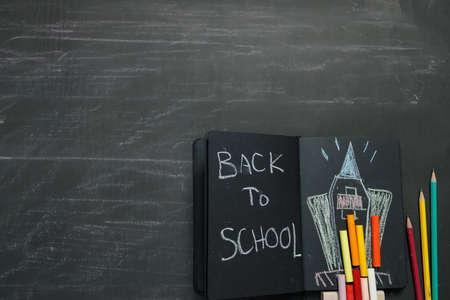 Photo pour School supplies on black board background. Back to school concept. - image libre de droit
