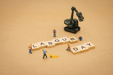 Photo pour Miniature people standing with wood word Labour Day using as background Universal day concept and Health Day concept with copy space  for your text or design. - image libre de droit