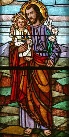 Stained glass with st. Joseph holding baby Jesus