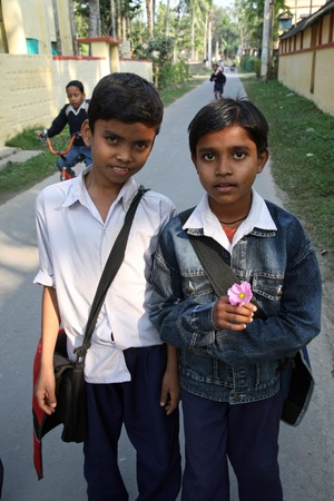 SONAKHALI, INDIA - JANUARY 13: two friends going to school  on January 13, 2009. Sonakhali, West Bengal, India. Education has been made free for children for 6 to 14 years of age in India.