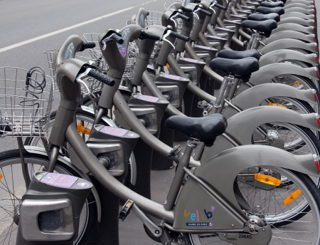 PARIS, FRANCE - NOVEMBER 07, 2012: Velib bucycles in the row on January 6, 2012 in Paris, France. Velib is a large-scale public bicycle sharing system in Paris, France.