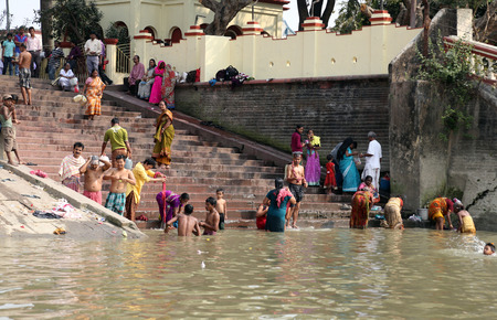 Hindu people bathing in the ghat near the Dakshineswar Kali Temple on February 14, 2014  At present time this river is being polluted tremendously