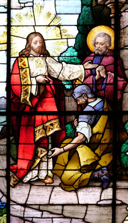 Jesus and the centurion. Lord, I am not worthy to have you come under my roof, stained glass window in the Basilica of the Sacred Heart of Jesus in Zagreb, Croatia on May 28, 2015