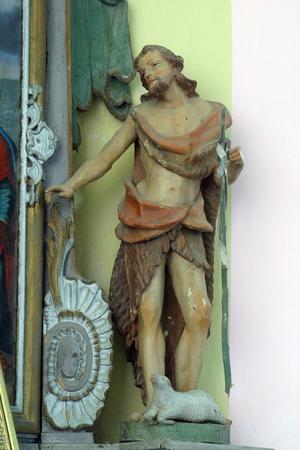Saint John the Baptist statue at the altar in the Parish Church of Saint Martin in Pisarovinska Jamnica, Croatia