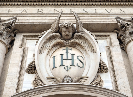 Photo for Christogram IHS, facade of the Church of the Gesu, mother church of the Society of Jesus, Rome, Italy - Royalty Free Image