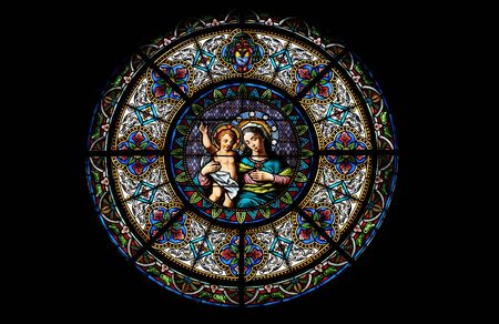 Foto de Virgin Mary with baby Jesus, stained glass window in the Cathedral of Saint Lawrence in Lugano, Switzerland - Imagen libre de derechos