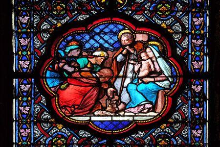 Foto de Nativity Scene, Adoration of the Magi, stained glass window in the Basilica of Saint Clotilde in Paris, France - Imagen libre de derechos