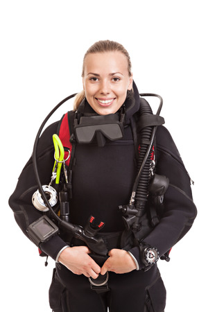Attractive blonde female underwater swimmer wearing black wetsuit with diving equipment. Isolated on white background.