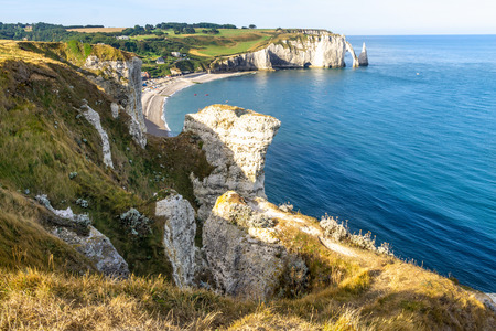 Photo for Beautiful natural rock arch. Aval cliff. Etretat, Normandy, France. - Royalty Free Image