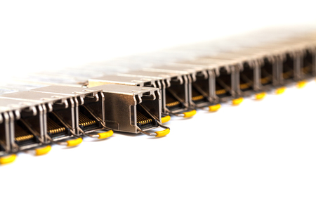 Row of Internet SFP (Small Form-factor Pluggable)  network modules for network switch. Close up. Isolated.