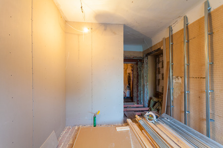 Photo pour Interior of upgrade apartment with materials during on the remodeling, renovation, extension, restoration, reconstruction and construction. ( making wall from gypsum plasterboard) - image libre de droit