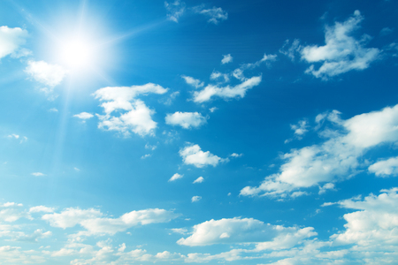 Foto de Blue sky with clouds and sun. - Imagen libre de derechos