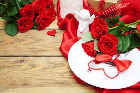 Photo pour Served table for Valentines Dinne with fork and knife on wooden table - image libre de droit