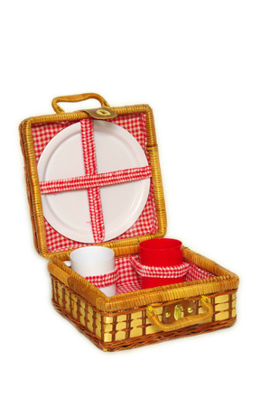 A wicker picnic handbasket for picnic needs