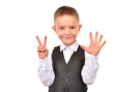 Photo pour The boy is seven years old. The boy on a white background. - image libre de droit
