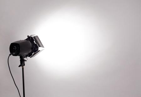 empty studio background and flash light on light grey