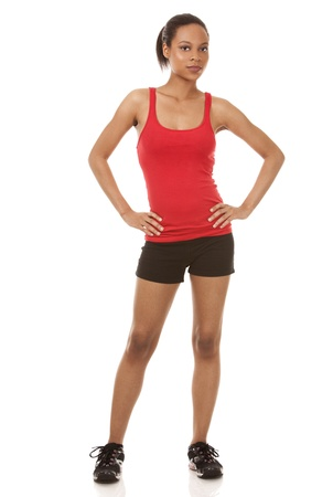 beautiful black woman wearing red fitness outfit on white background